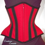 Red cotton twill Tulip style underbust corset with black grosgrain stays and black trim. - 2011